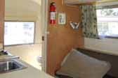 Photo of 1967 Airstream Caravel trailer interior, looking towards the bathroom