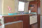 Very efficient and functional kitchen in 1968 Airstream Caravel Trailer