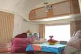 1968 Airstream Tradewind trailer with comfy and inviting dining room
