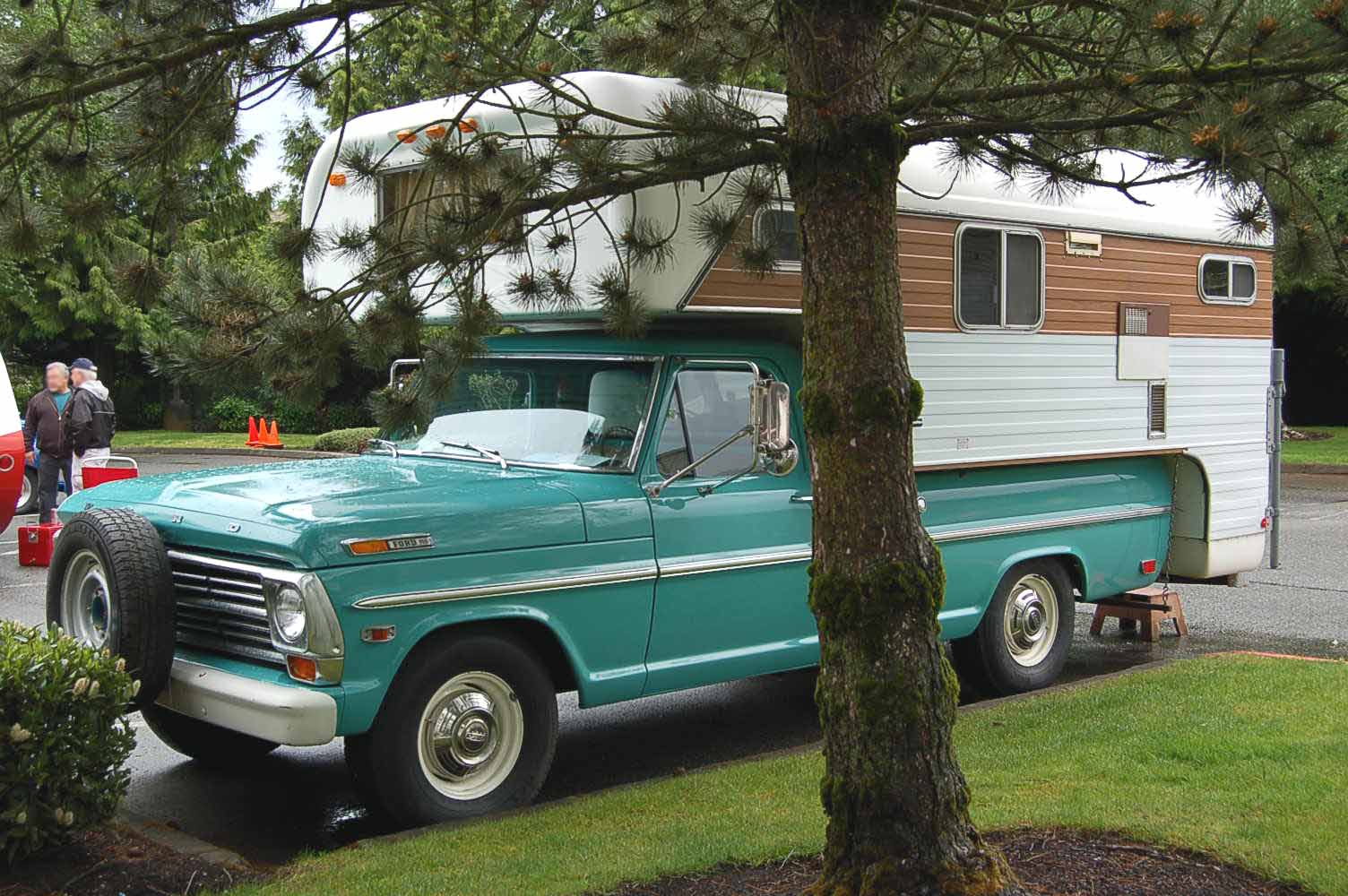 Photo of an original 1968 ford pickup truck out camping with a classic chinook camper shell