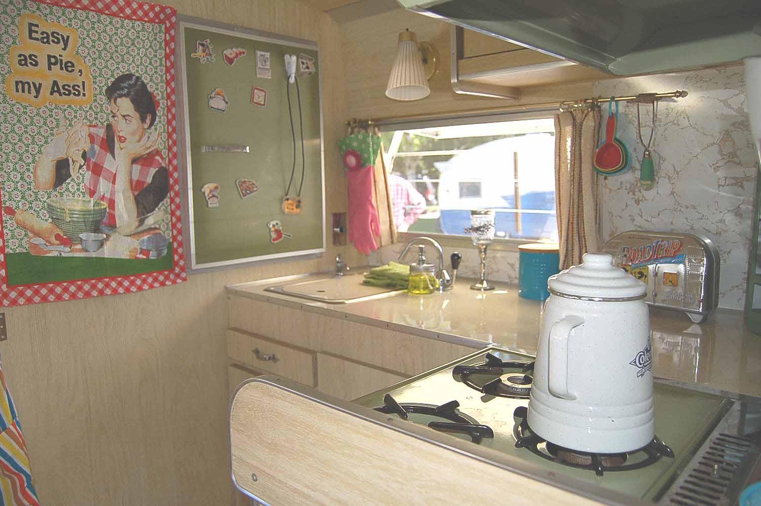 White washed kitchen cabinets in vintage 1968 shasta loflyte trailer