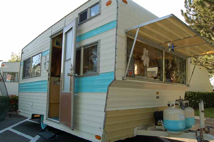 Image shows the front end of a vintage Aladdin Trailer painted light blue and white