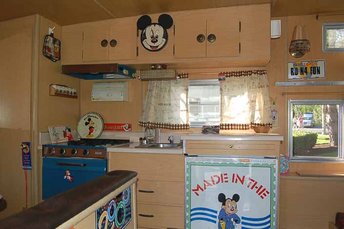 Fun Mickey Mouse and Disney decorations in the Kitchen of an Aladdin Vintage Trailer