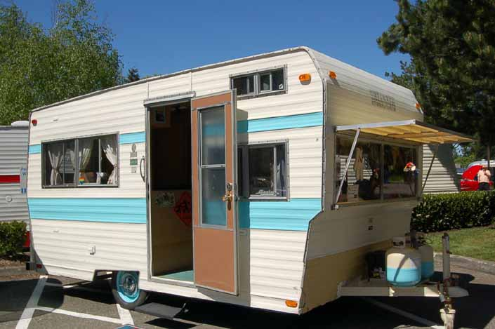 Image shows a very nicely restored Aladdin Vintage Travel Trailer