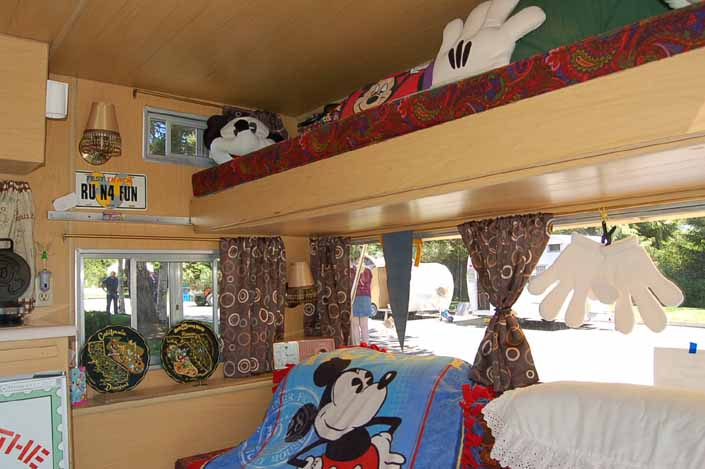 Photo shows fun Mickey Mouse decorations in the bedroom area of an Aladdin Vintage Travel Trailer
