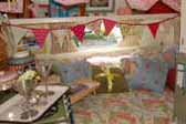 Beautiful decorations in sleeping area in 1969 Shasta Starflyte Trailer