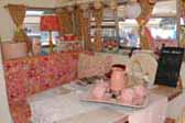 Stylish pink and white decorations in dining area of 1969 Shasta Starflyte Travel Trailer