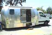 Very practical custom truck based camper is an Airstream Trailer installed on a heavy-duty truck frame