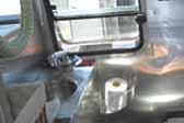 Practical Airstream Trailer-camper has a beautiful bathroom with all aluminum walls and counter-top