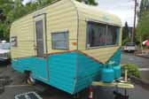 Picture of a vintage Aladdin travel trailer with a great teal and light cream yellow paint job