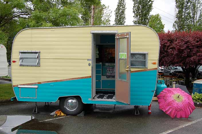 Image shows the side of an Aladdin Vintage Trailer at the XXX Root Beer Issaquah Trailer Rally in Washington State
