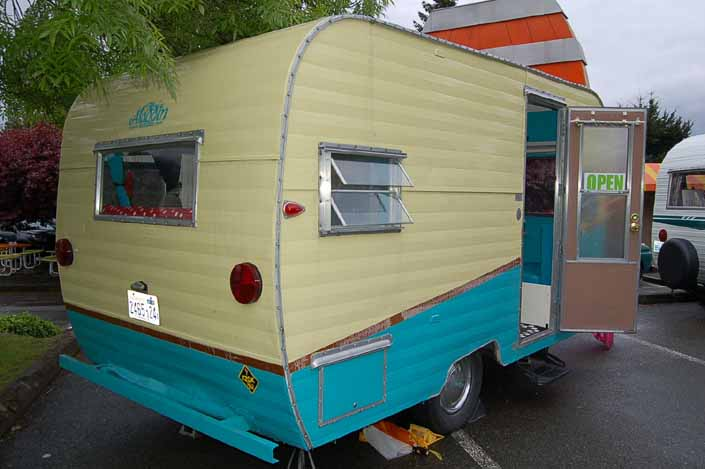 Image shows the rear end of an Aladdin Vintage Trailer at the XXX Root Beer Issaquah Trailer Rally in Washington State