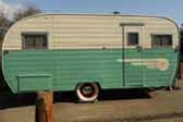 Long vintage Aljoa travel trailer camping on the California Coast