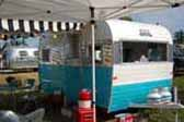 Nicely restored vintage Aloha travel trailer with sky blue and white paint colors
