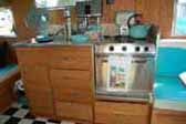 Picture of awesome kitchen cabinets, countertop and appliances in nicely restored Aloha trailer