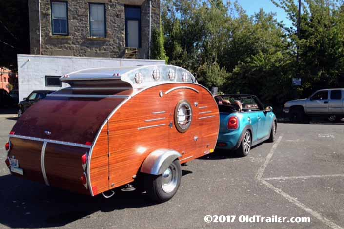 This vintage towing rig is a mini cooper convertible pulling a custom-made teardrop trailer
