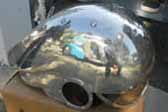 Photo of awesome Flash Gordon-inspired motorcycle helmet hand formed in aluminum and rivets by Randy Grubb