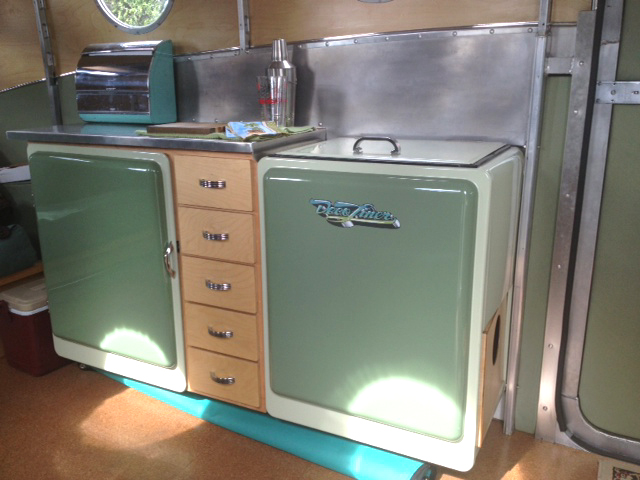 Photo Of Decoliner Motorhome Interior Showing Kitchen Counter And Stylish Cabinets