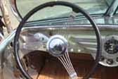 Classic banjo steering wheel in Decoliner Motor Home top level driver's seat