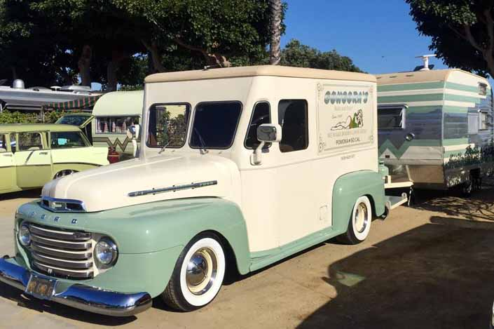 This vintage towing rig is a 1950 ford milk truck pulling a vintage winnebago travel trailer