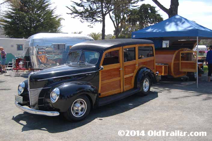 This vintage towing rig is a 1940 ford woodie station wagon pulling a woodie teardrop trailer