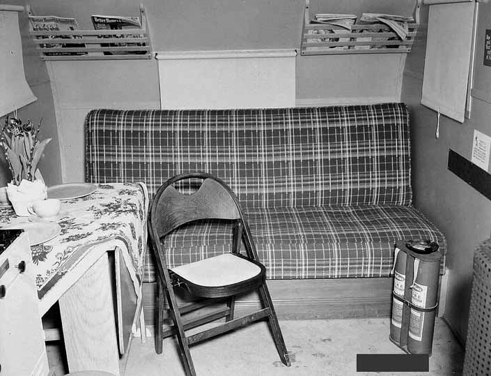 Government photo shows the interior of a 1940's model canned ham trailer supplied by the Government, at the Hanford Trailer Camp in Washington