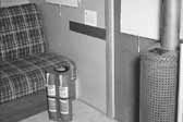 Old photo shows the interior of a 1940's model canned ham trailer supplied by the Government, at the Hanford Trailer Camp in Washington