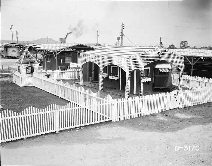 Government photo shows a 1940's worker's trailer, surrounded by a beautiful white picket fence, at Project Hanford Trailer City
