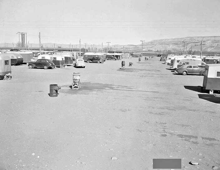 Government photo shows a group of 1940's Travel Trailers that housed workers and their families, at Project Hanford Trailer City in Washington