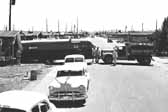 Historical photo shows a newly arrived travel trailer being backed into place, at Project Hanford Trailer City in Washington