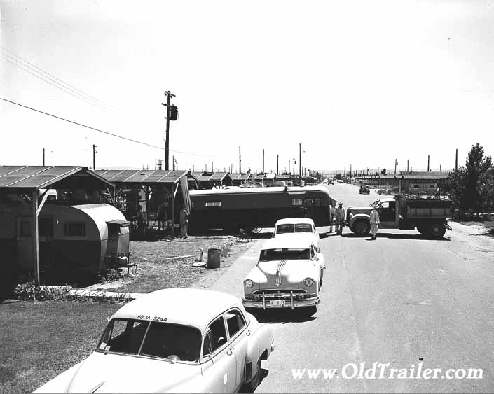 Government photo shows a newly arrived travel trailer being backed into place, at Project Hanford Trailer City in Washington