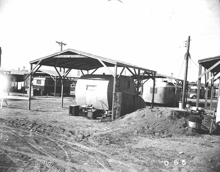 Government photo shows the worker's 1940's trailers under shade covers, at the Project Hanford Trailer City in Washington