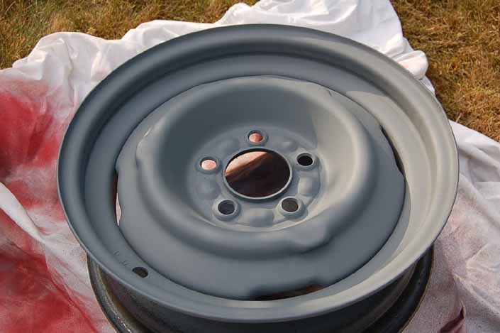 Photo shows the trailer wheel primed and ready for the spray painted color coats to be applied