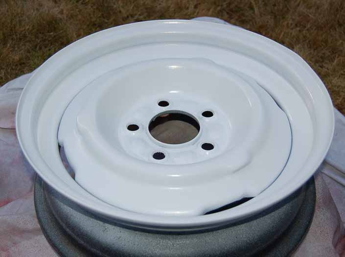 Picture Of The Red Trailer Wheel That Has Been Painted With 4 Coats Gloss White