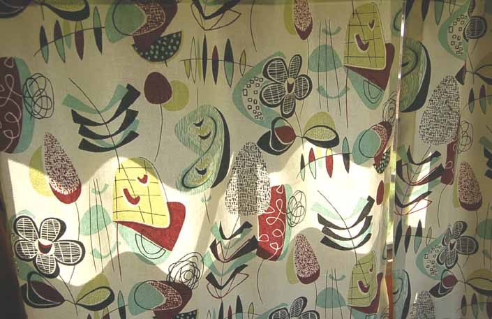 This photo shows a swatch of retro fabric with a jazzy mid-century boomerangs and dingbats pattern, for your vintage trailer