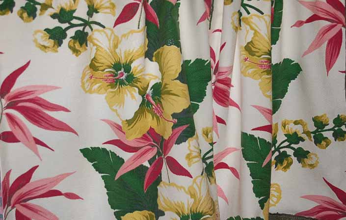 This photo shows a swatch of retro fabric with a tropical flowers on white background pattern, for your vintage trailer