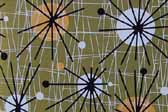 This image is a sample of a great looking retro fabric pattern with mid-century starbursts for your vintage trailer