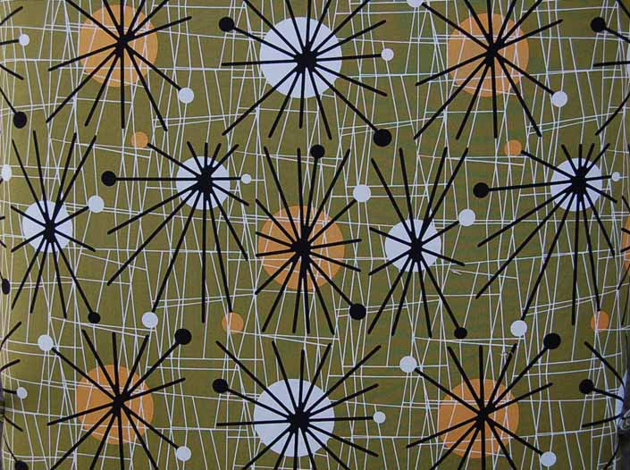 This photo shows a swatch of retro fabric with mid-century starbursts for your vintage trailer