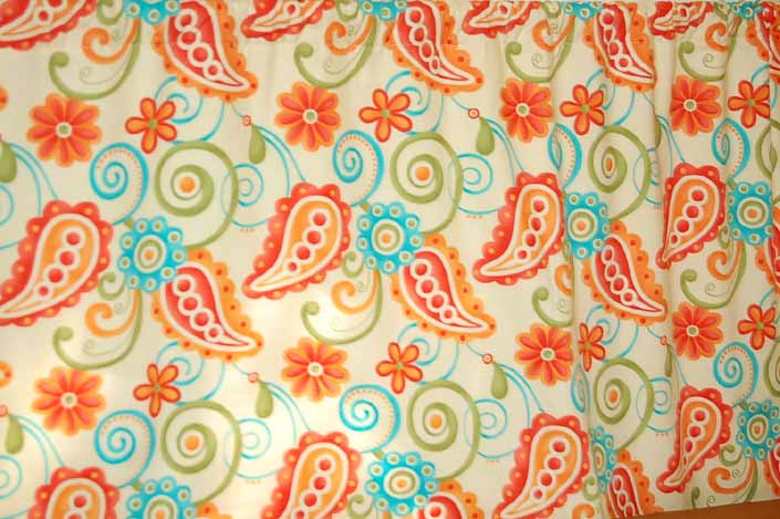 This photo shows a swatch of retro fabric with a 1960's psychedelic paisley design, for your vintage trailer