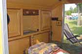 Expertly Built Oak Cabinets in Custom Teardrop Trailer Sleeping Quarters