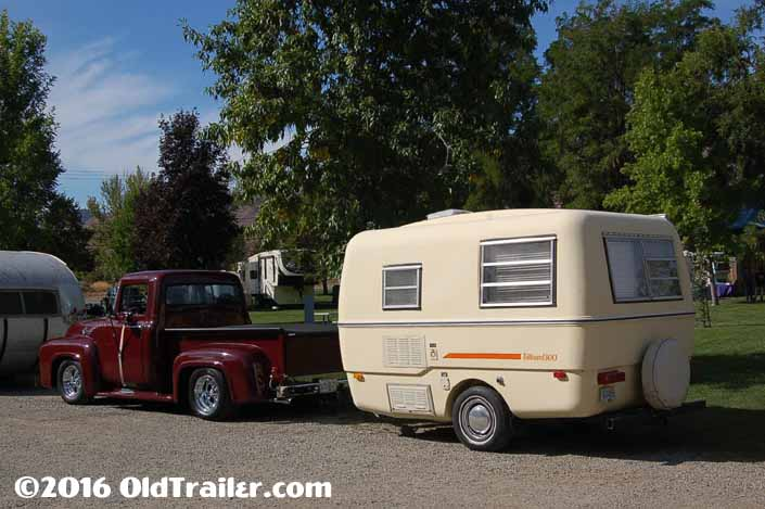 This vintage towing rig is a classic ford pickup truck pulling a fiberglass trillium travel trailer