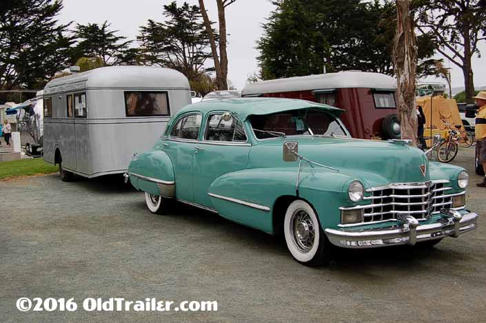 This vintage towing rig is a vintage cadillac 4-door sedan pulling a vintage 1937 pierce-arrow travelodge trailer