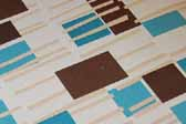 This photo shows a swatch of retro fabric with mid-century geometrics designs, for your vintage trailer