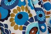 This photo shows a swatch of retro fabric with a 60's flower design for your vintage trailer