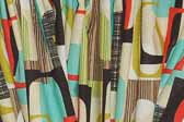 This photo shows a swatch of retro fabric with a 1960's go-go graphics pattern, for your vintage trailer