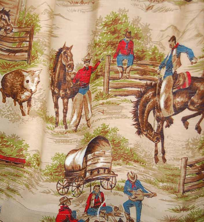 This photo shows a swatch of retro fabric with a classic 1950's cowboys, horses and chuck wagon pattern, for your vintage trailer