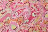 This photo shows a swatch of retro fabric with a 1960's psychedelic paisley pattern, for your vintage trailer