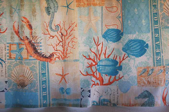 This photo shows a swatch of retro fabric with great 60's nautical feel with undersea creatures, for your vintage trailer