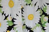 This image is a sample of a great looking retro fabric pattern showing Bright Daisies on a Black Background, for your vintage trailer