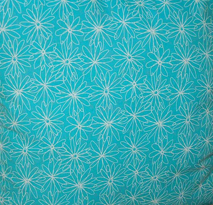 This photo shows a swatch of retro fabric with 1960's white flower graphics on a turquoise background, for your vintage trailer